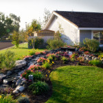 A wide look at this extensive front yard water feature